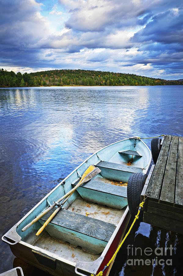 Rowboat Photograph - Rowboat Docked On Lake by Elena Elisseeva