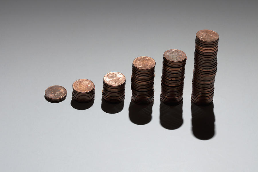Horizontal Photograph - Rows Of Stacks Of Five Cent Euro Coins Increasing In Size by Larry Washburn