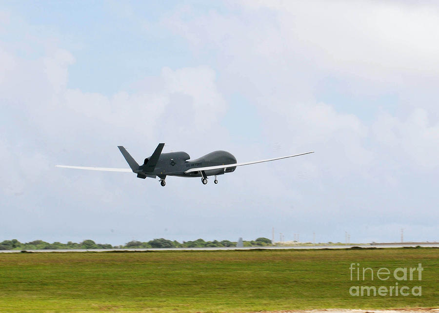 Aviation Photograph - Rq-4 Global Hawks First Flight by Photo Researchers