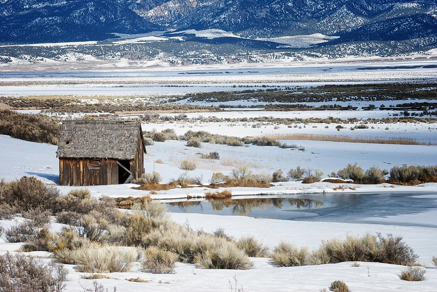 Barn Photograph - Rustic Barn In A Snowy Valley Next To A Pond by C Thomas Willard