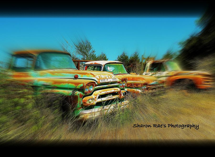Rusting Away Photograph by Sharon Farris