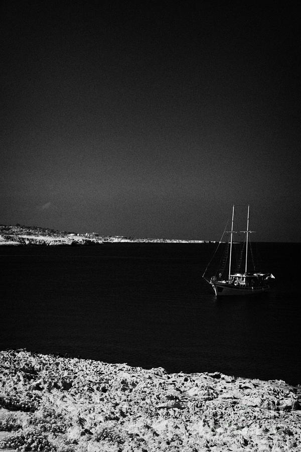 Sailing Photograph - Sailing Boat Moored In A Quiet Bay Near Cape Gkreko Greco Republic Of Cyprus by Joe Fox