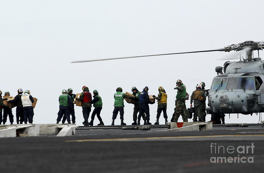 Maritime Photograph - Sailors And Marines Load Supplies Onto by Stocktrek Images