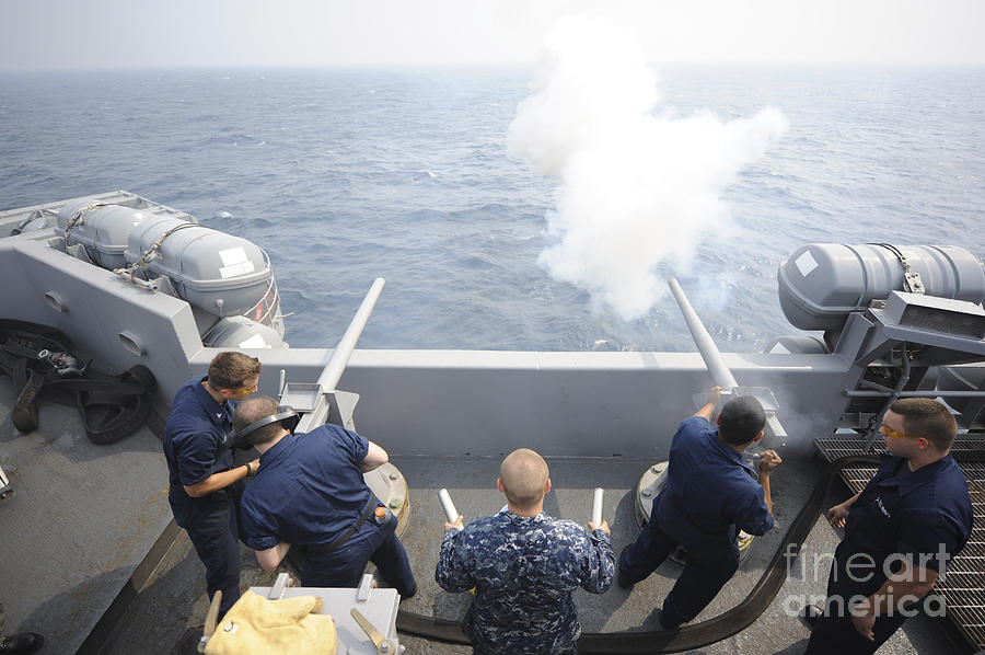 Weapon Photograph - Sailors Perform A 21-gun Salute Aboard by Stocktrek Images