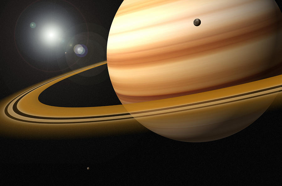 saturn glowing stars and a moon of saturn photograph by