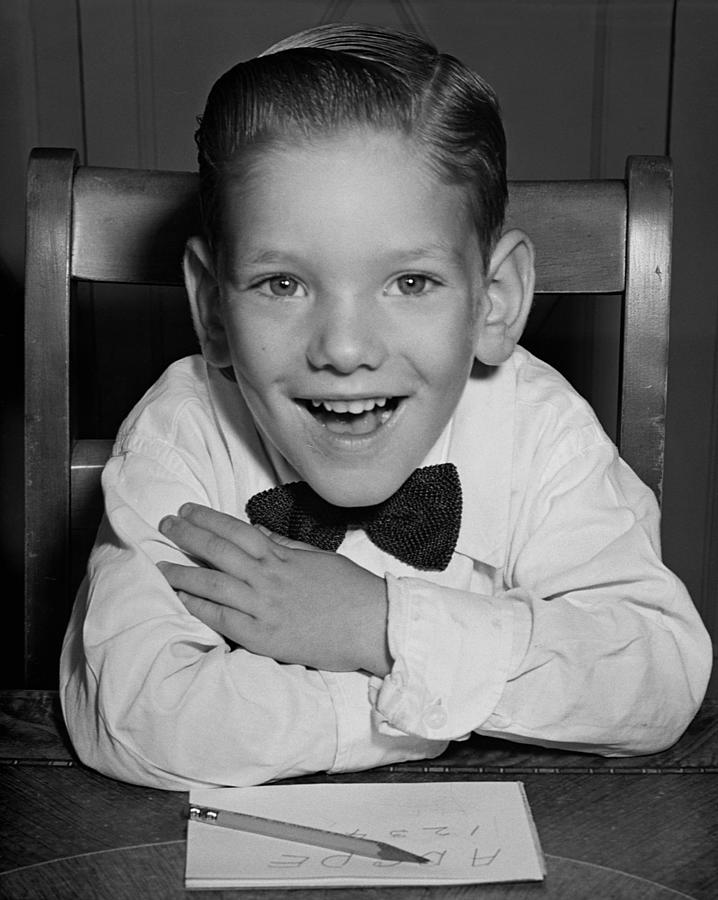 Child Photograph - Schoolboy At Desk by George Marks