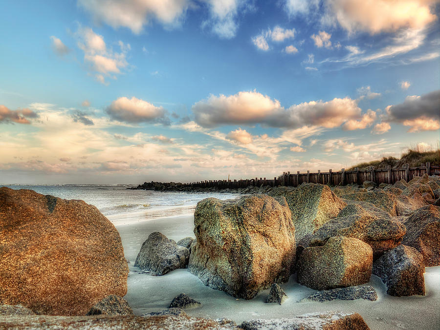 Shoreline Rocks And Fence Posts Folly Beach Photograph by Jenny Ellen Photography