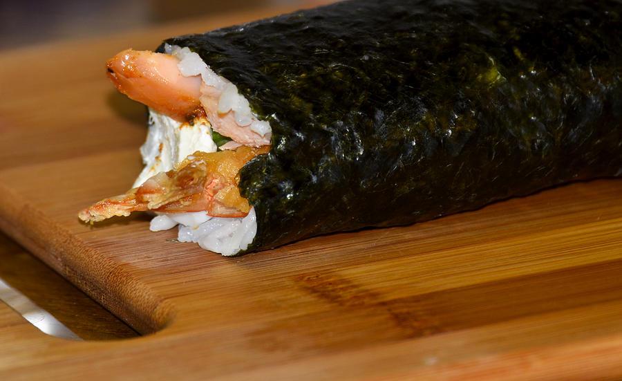 Cutting Board Photograph - Shrimp Sushi Roll On Cutting Board by Carolyn Marshall