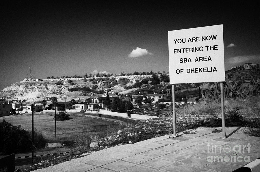 Sba Photograph - sign overlooking pyla and turkish controlled territory marking entrance of SBA Sovereign Base area by Joe Fox