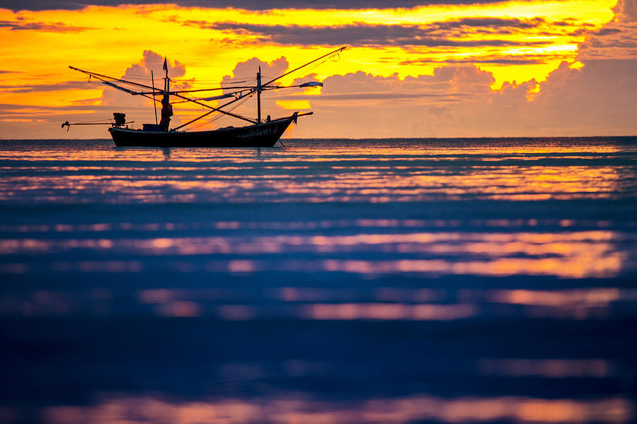 Boat Photograph - Silhouette Boat At Sea by Arthit Somsakul