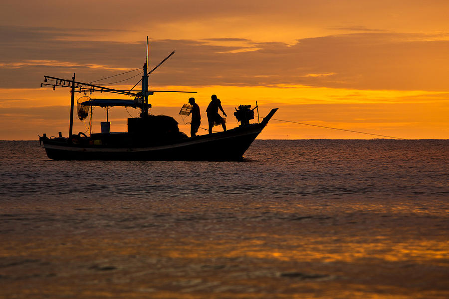 Silhouette Photograph - Silhouette Fisherman Boat Sunset Huahin Thailand by Arthit Somsakul