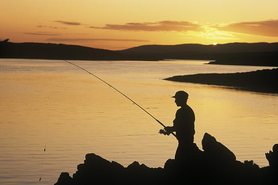 Silhouette Of A Fisherman Fishing On Photograph by The Irish Image Collection