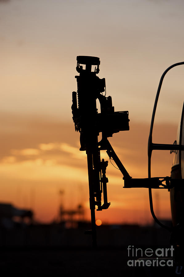 Aviation Photograph - Silhouette Of A M240g Medium Machine by Terry Moore