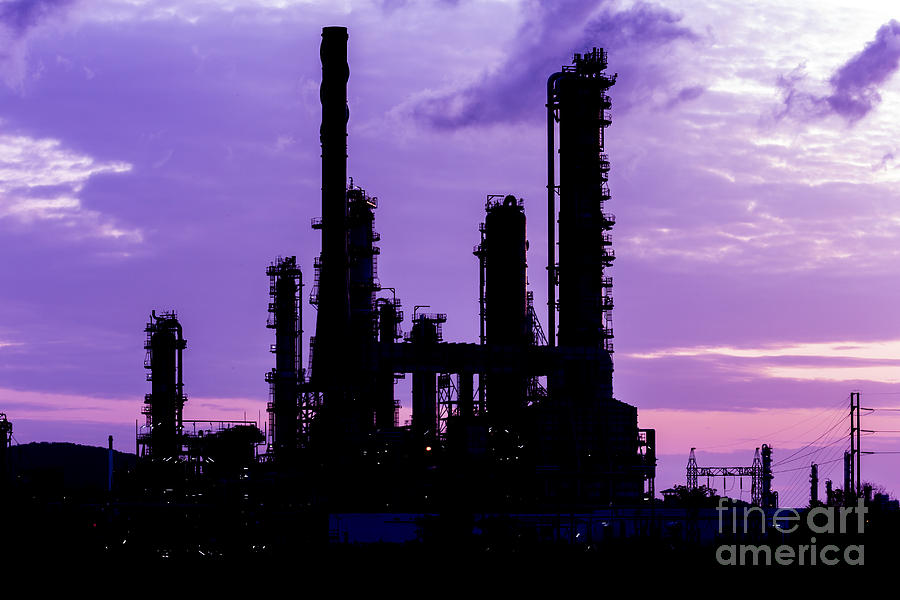 Blue Photograph - Silhouette Of Oil Refinery Plant At Twilight Morning by Mongkol Chakritthakool