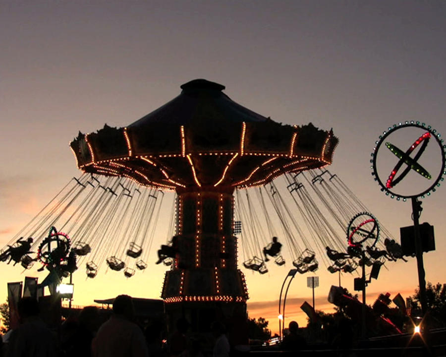 Amusement Photograph - Silhouetted Amusement Ride by Kim French