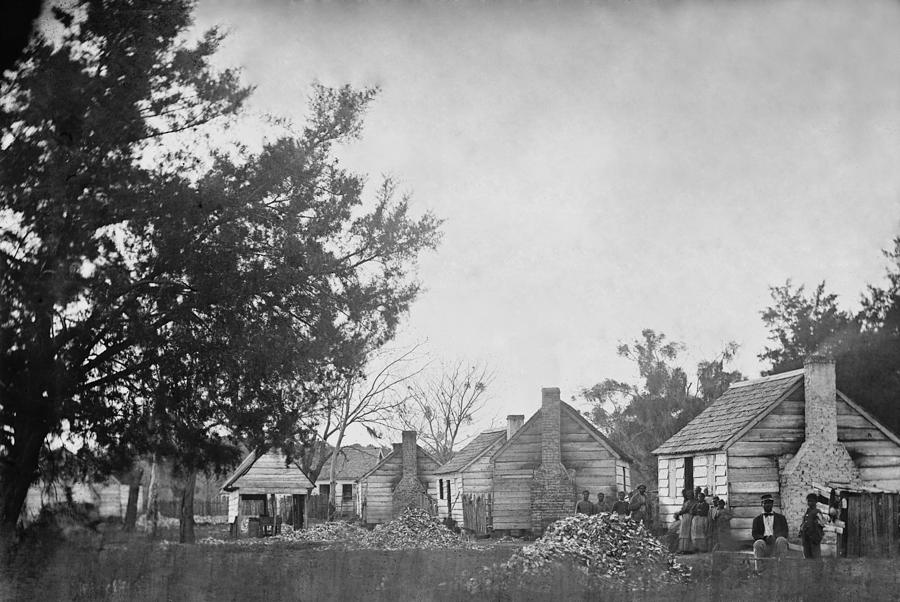 History Photograph - Slaves Sitting Near Their Cabins by Everett