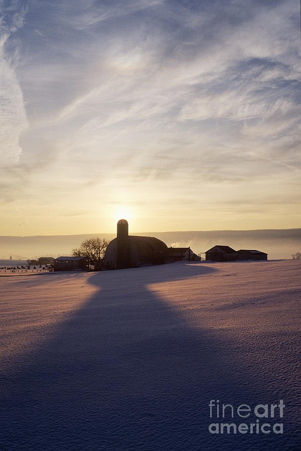 Amish Photograph - Snow Covered Field With Farm Silhouette At Sunset by Jeremy Woodhouse