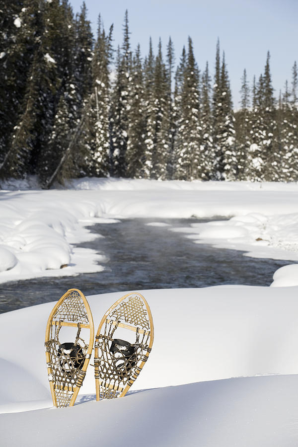 Blue Sky Photograph - Snowshoes By Snowy Lake Lake Louise by Michael Interisano