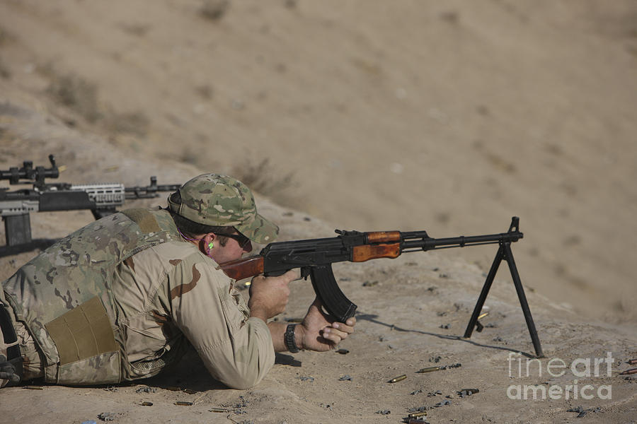 Us Navy Photograph - Soldier Fires A Russian Rpk Kalashnikov by Terry Moore