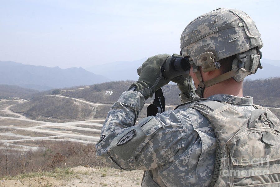 Military Photograph - Soldier Observes An Adjust Fire Mission by Stocktrek Images