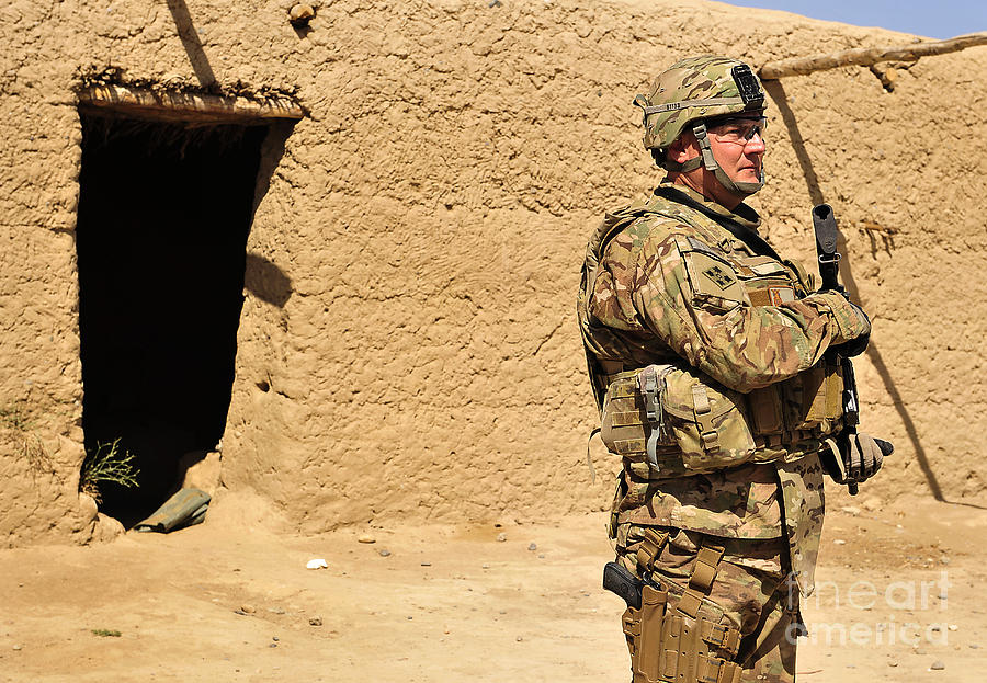 Army Photograph - Soldier Stands Guard During A Routine by Stocktrek Images