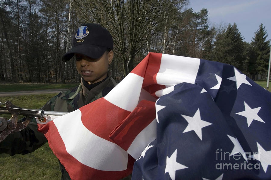 Horizontal Photograph - Soldier Unfurls A New Flag For Posting by Stocktrek Images