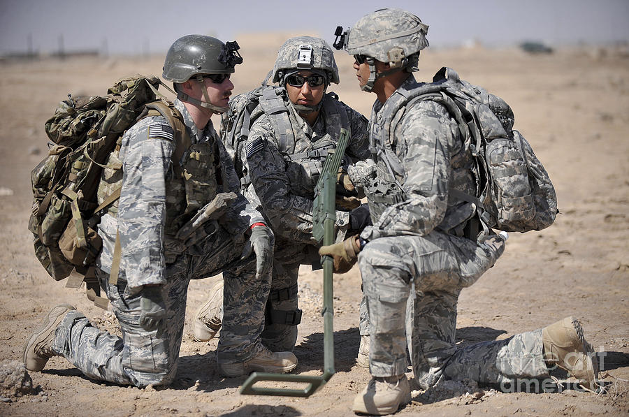 Iraq Photograph - Soldiers Discuss A Strategic Plane by Stocktrek Images
