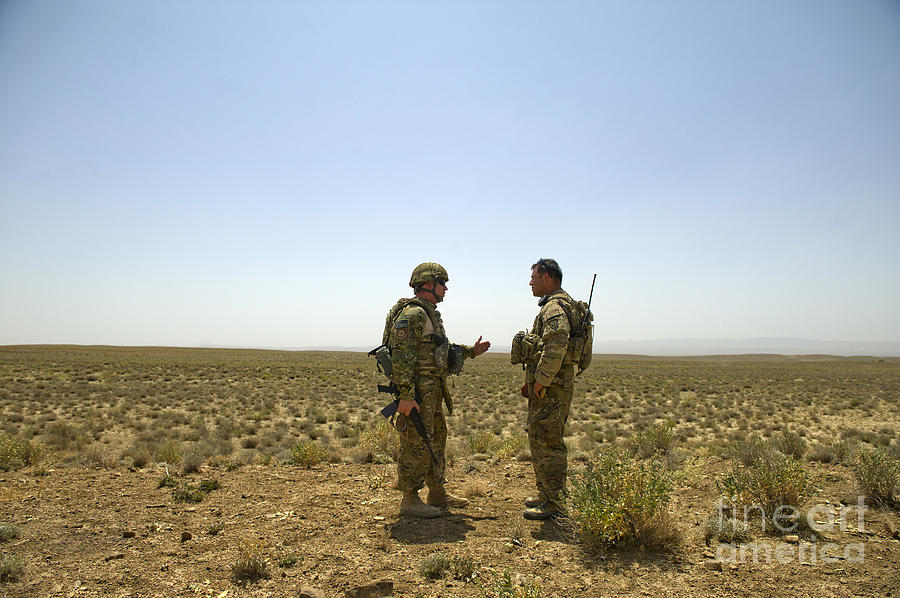 Afghanistan Photograph - Soldiers Discuss, Drop Zone by Stocktrek Images