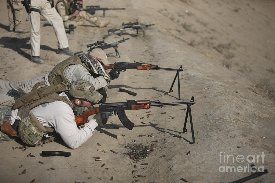Cartridge Photograph - Soldiers Fire A Russian Rpk Kalashnikov by Terry Moore