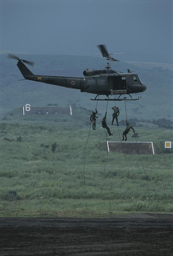Armed Forces Photograph - Soldiers Rappel From A Helicopter by Karen Kasmauski