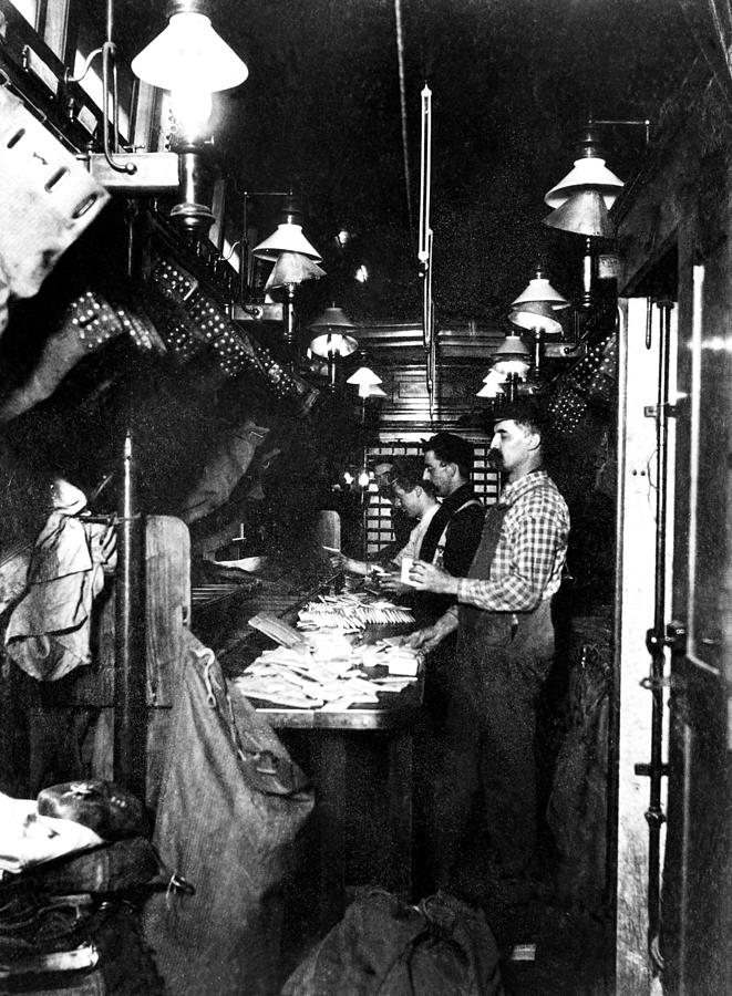 1930s Photograph - Sorting The Mail In A Railway Post by Everett