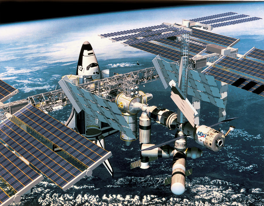 Horizontal Photograph - Space Shuttle Docked At The Space Station In Outer Space by Stockbyte