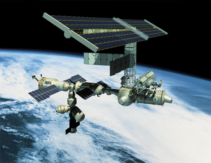 Horizontal Photograph - Space Station In Orbit by Stockbyte