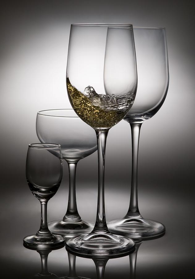 Abstract Photograph - Splashing Wine In Wine Glasses by Setsiri Silapasuwanchai
