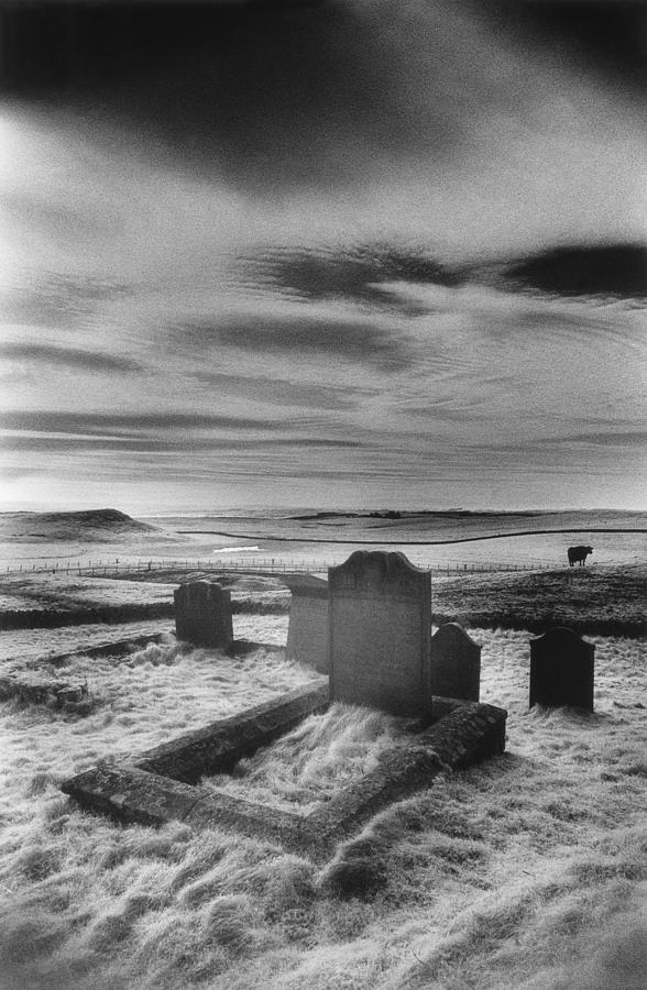 Cemetery; Graveyard; Graves; Church Yard; Tombs; Gravestones; Tombstones; Grave Stones; Bleak; Desolate; Atmospheric; Eerie; Spooky; Landscape; Rural; Countryside; Remote; Isolated; Gothic; Haunted Photograph - St Aidans Churchyard by Simon Marsden