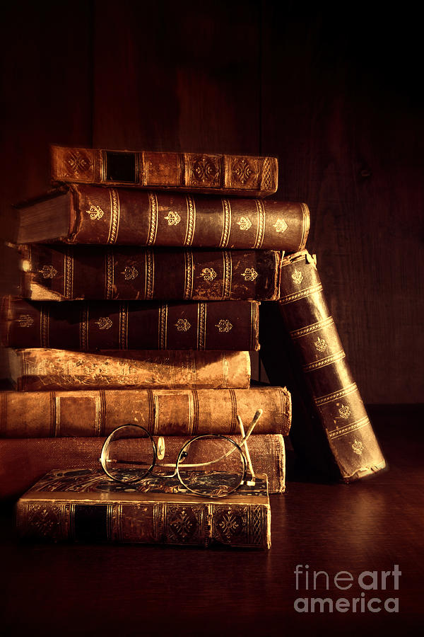 Stack Of Old Books With Reading Glasses Photograph By