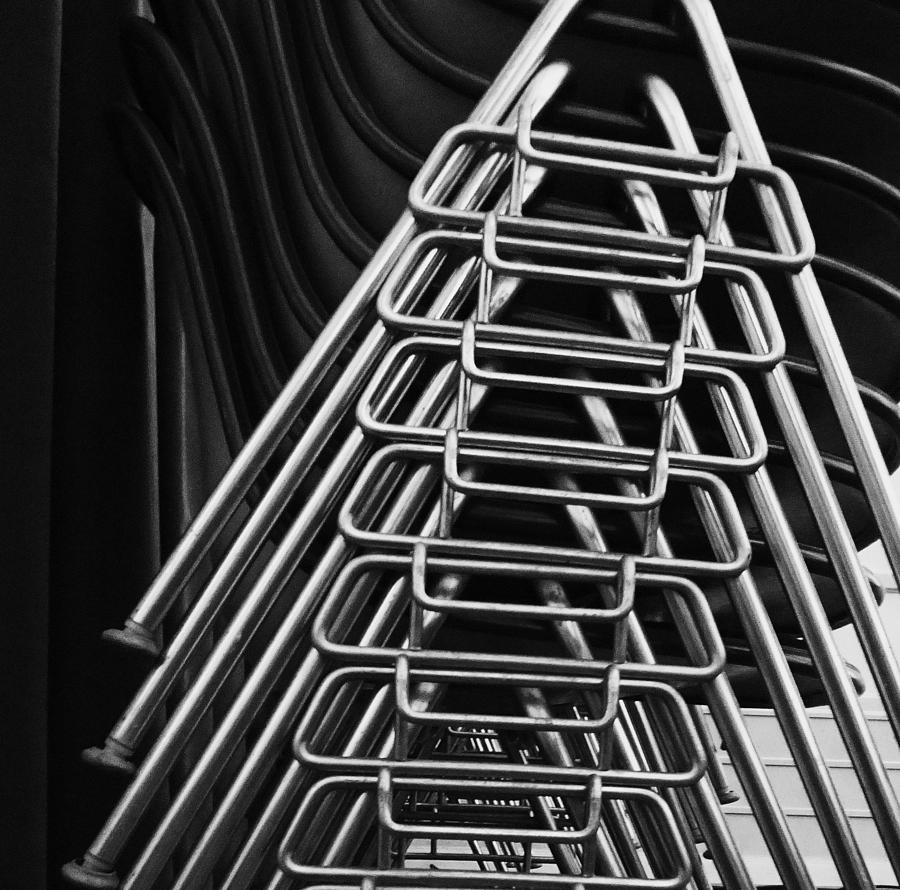 Abstract Photograph - Stacks Of Chairs by Anna Villarreal Garbis