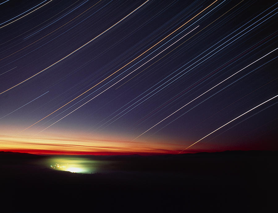 Star Trails Photograph - Star Trails Over Queen Charlotte City, Canada by David Nunuk