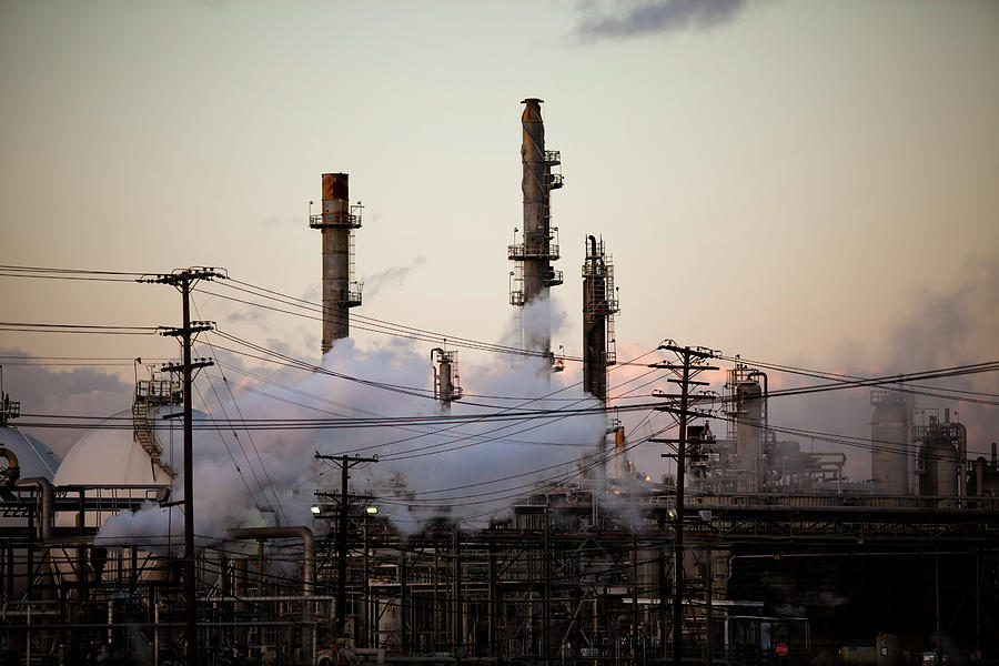 Horizontal Photograph - Steam Plumes At Oil Refinery by Hal Bergman