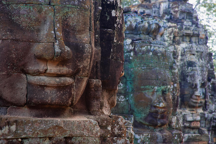 Ancient Photograph - Stone Heads At Bayon Temple by Carson Ganci