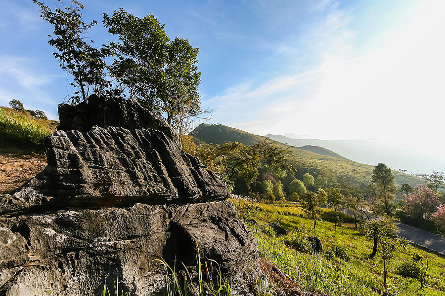 Active Photograph - Stone On Hill With Cloudy And Blue Sky by Kittipan Boonsopit