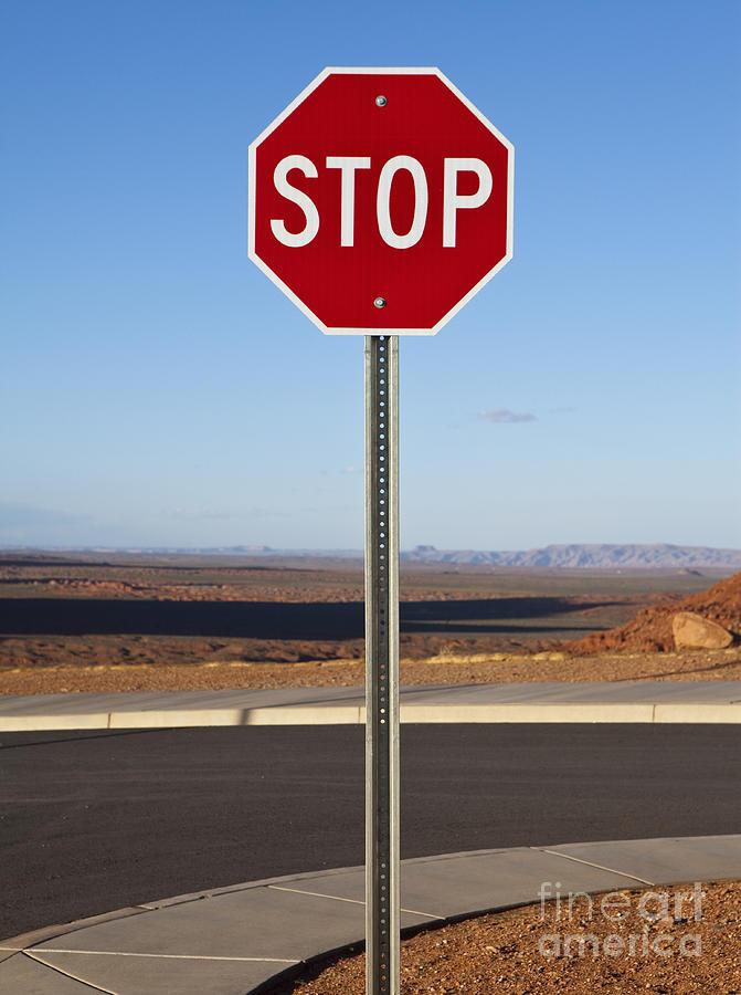 Arid Photograph - Stop Sign In The Desert by Paul Edmondson