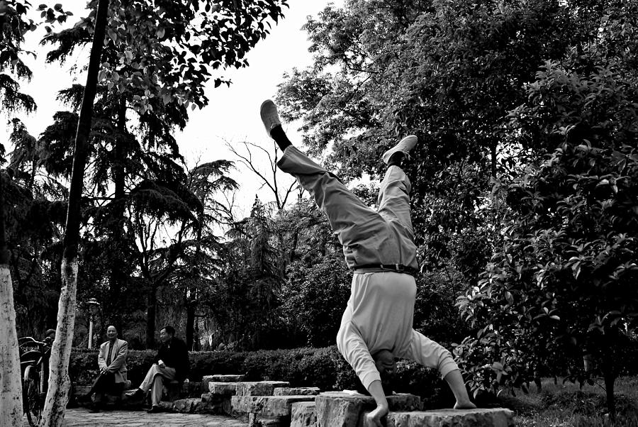Handstand Photograph - Street Scene 1 - Chinese Upside Down In The Park Guy by Dean Harte