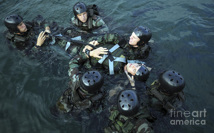 Navy Seals Photograph - Students Secure A Simulated Casualty by Stocktrek Images