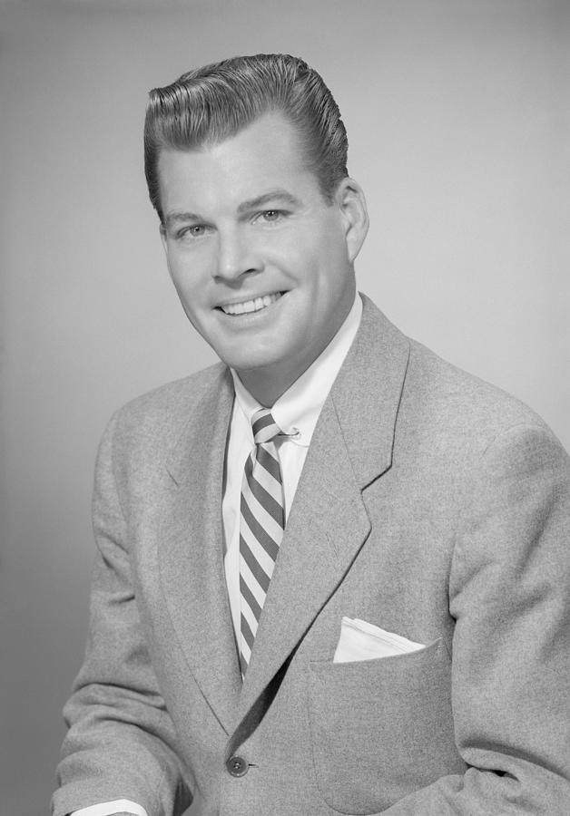 Adult Photograph - Studio Portrait Of Mid Adult Man Smiling by George Marks