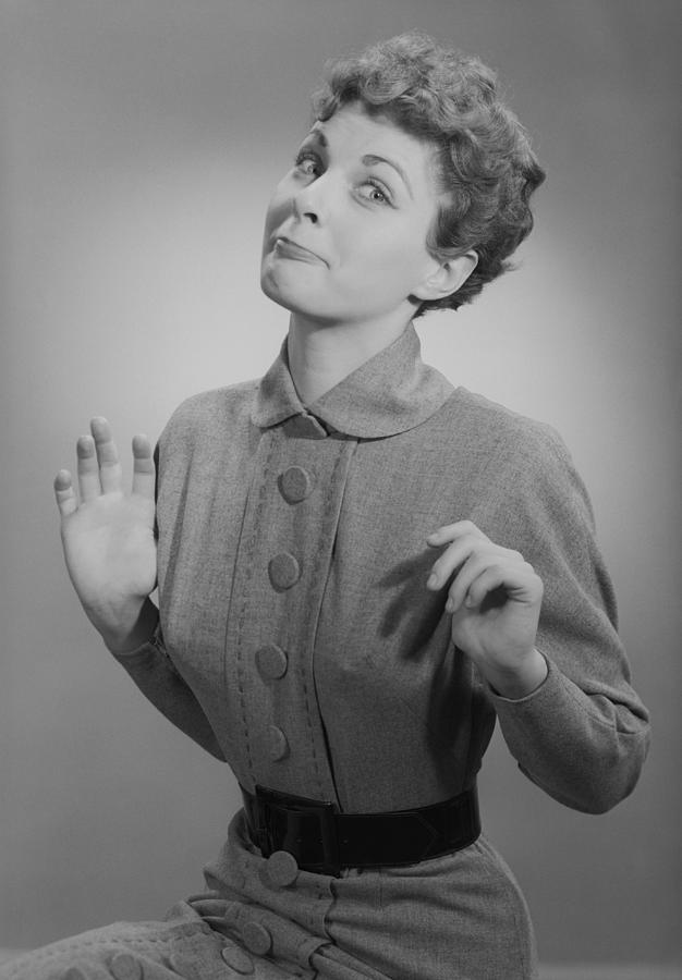 Adult Photograph - Studio Portrait Of Mid Adult Woman Making Face by George Marks