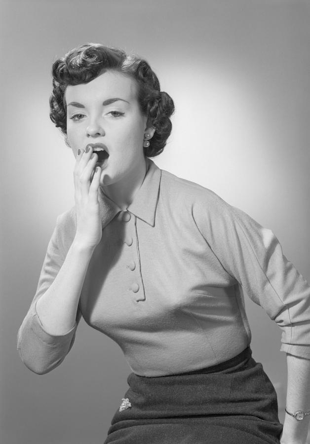 Adult Photograph - Studio Portrait Of Woman Yawning by George Marks
