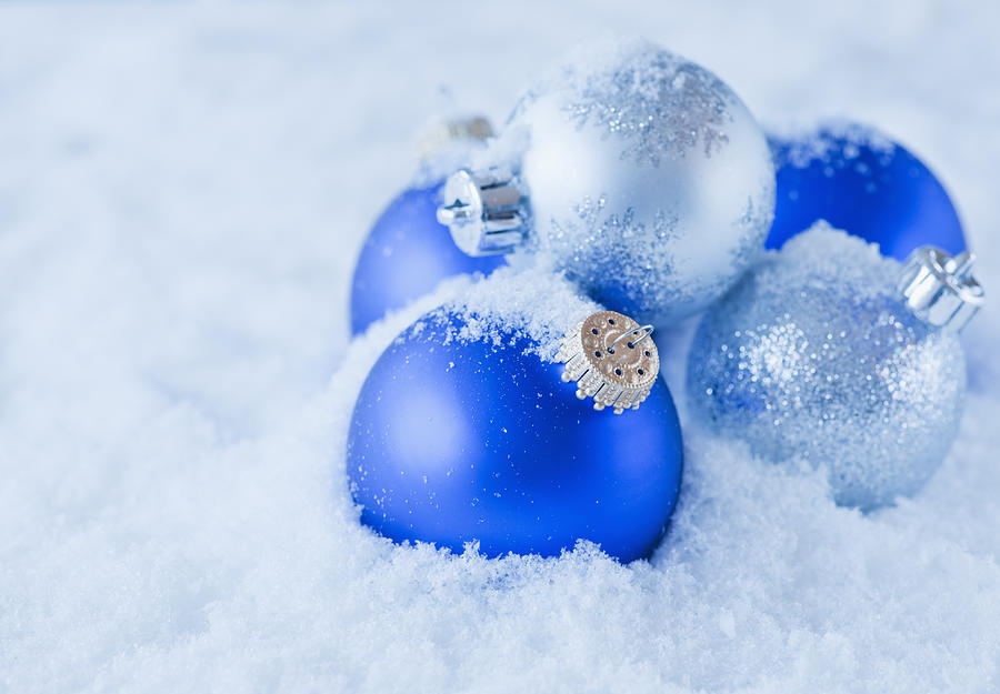 horizontal photograph studio shot of blue and silver christmas ornament on snow by daniel grill - Blue Christmas Ornaments