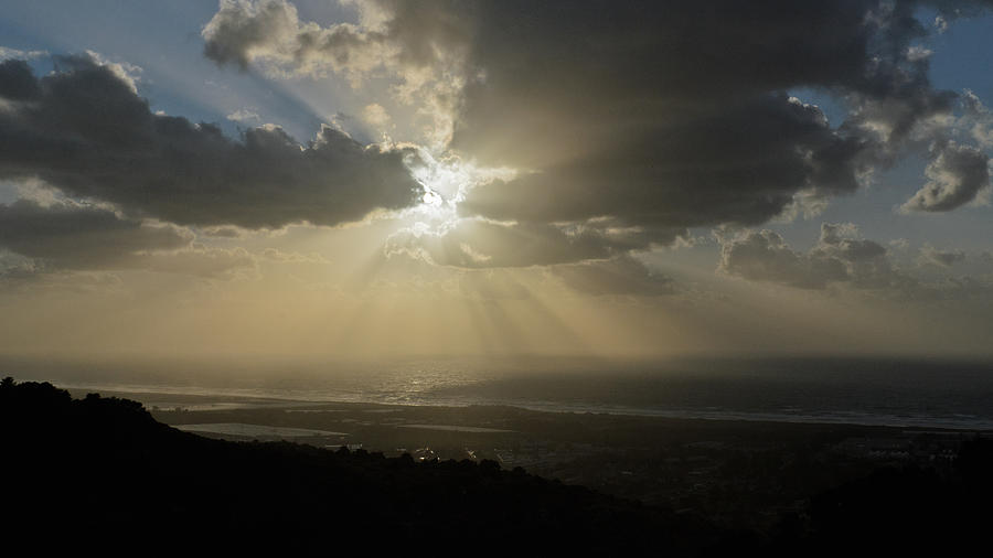 Atmosphere Photograph - Sun and clouds over sea by Michael Goyberg
