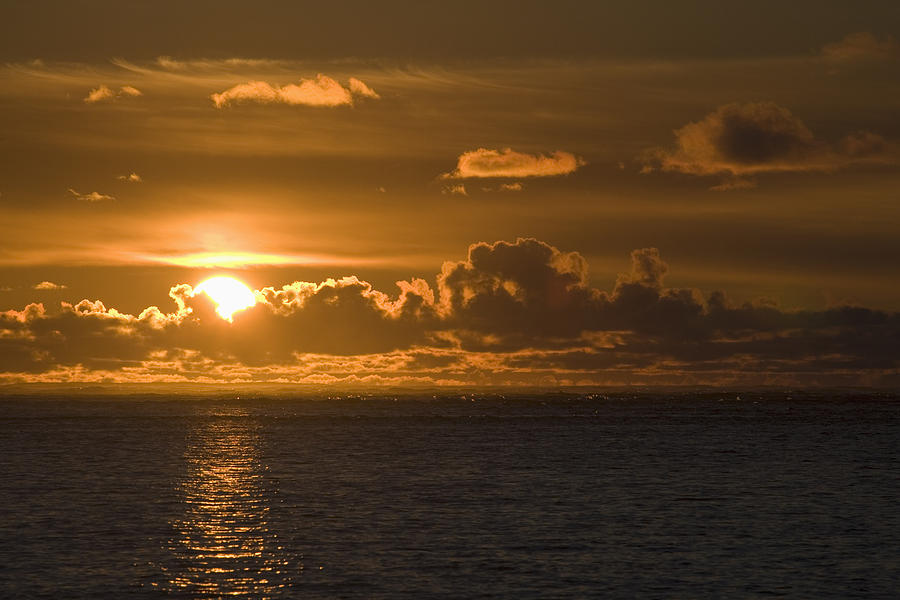 Cloud Photograph - Sun Setting On The Ocean With The by Michael Interisano